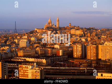 Sacre-Coeur and Eiffel Tower above Paris skyline at sunrise - Stock Photo