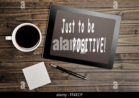 Just to be positive text written on digital tablet - Stock Photo