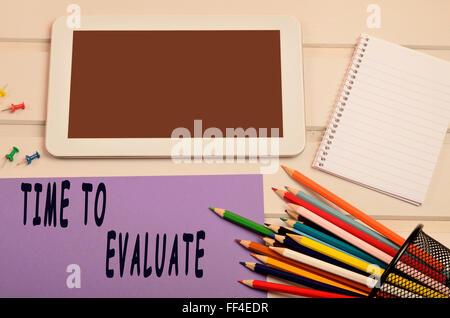 Time to evaluate words on purple paper - Stock Photo