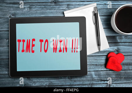 Time to win text on digital tablet - Stock Photo