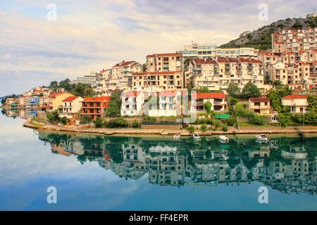 The nice reflection of a small village in europe in the silent morning bay.  Neum in Bosnia Herzegovina. Silent - Stock Photo