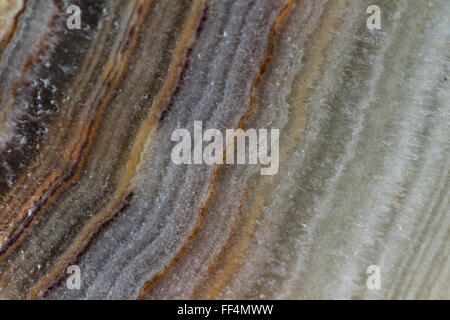 close up of a beautiful polished stone with a beautiful pattern with layers and colors - Stock Photo