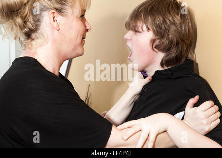 violent father hit the teenager of the family - Stock Photo