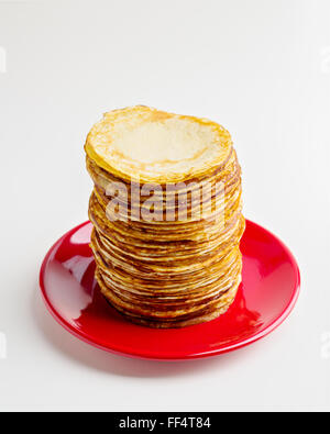 Pancake week. Pancakes on a plate isolated on a white background. Selective focus. - Stock Photo