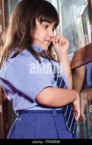 Asia Asian Asians Attire Bookshelf Bookshelves Choosing Close Up Contemplating Formal Attire Formal Clothes Formal - Stock Photo