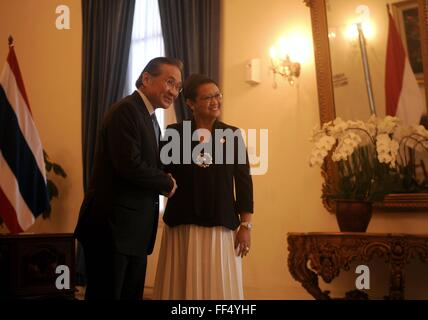 Jakarta. 11th Feb, 2016. Indonesian Foreign Minister Retno Marsudi (R) shakes hands with Thai Foreign Minister Don - Stock Photo