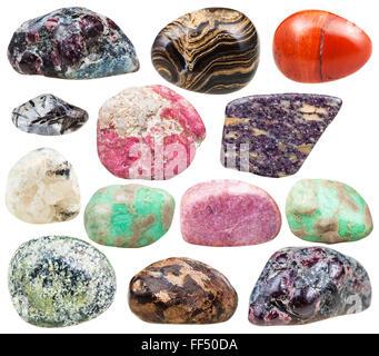 set of natural mineral tumbled gemstones - baryte, barite, garnet, almandine, alunite, serpentine, serpentinite, - Stock Photo