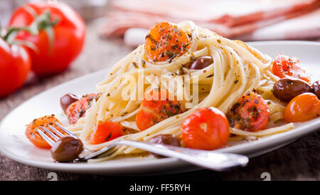 Pasta With Fresh Tomatoes And Olives - Stock Photo