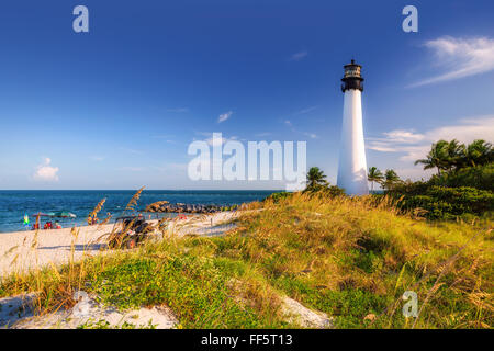 The Beach and Cape Florida lighthouse at sunset, Key Biscayne, Miami - Stock Photo