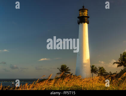 Famous lighthouse at sunset at Cape Florida in the south end of Key Biscayne , Miami - Stock Photo