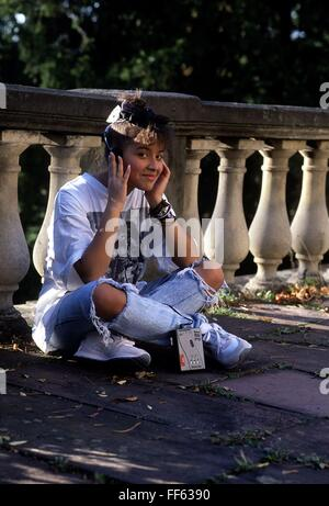 people, teenager, 1980s, exterior, girl with walkman, sitting on ground, circa 1989, Additional-Rights-Clearences - Stock Photo