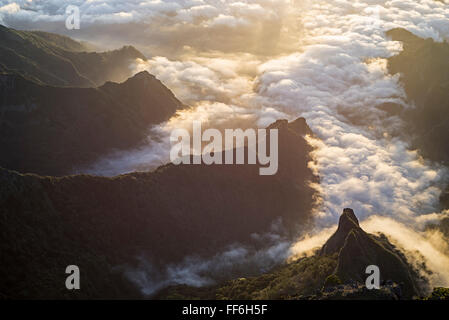 Sunrise over canyons and rugged valleys covered with clouds leading from the north coast to the central mountains - Stock Photo