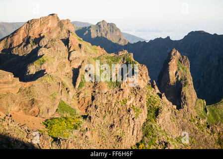 Spectacular panorama viewpoint Miradouro Minho da Manta in the rugged mountains of central Madeira at sunrise seen - Stock Photo