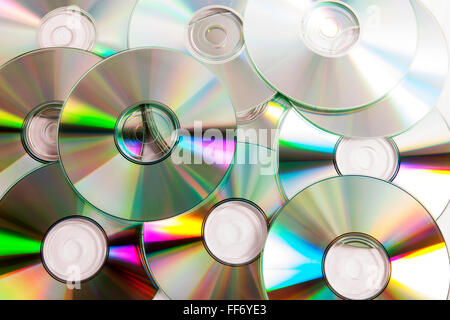 Cds cd dvd dvds discs digital data storage piracy disc full frame music pile stack studio burn information movie - Stock Photo