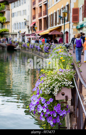 Beautiful flower pots along the canals in Annecy, France, known as the French Venice - Stock Photo
