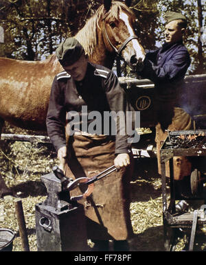 events, Second World War / WWII, back area, blacksmith of a German infantry unit working on a horseshoe, probably - Stock Photo
