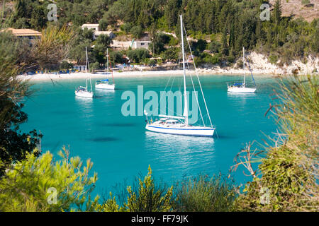 Lakka, Paxos, Ionian Islands, Greece. View from hillside over the clear turquoise waters of Lakka Bay, yachts at - Stock Photo