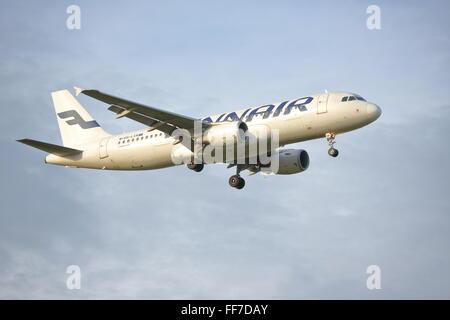Finnair Airbus A320-200 OH-LXM landing at Heathrow Airport, London - Stock Photo