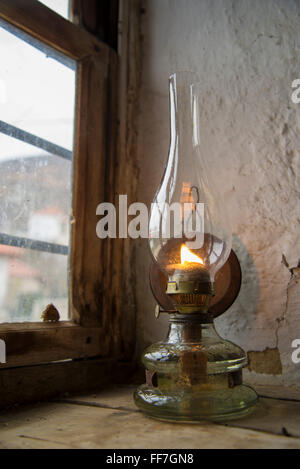 Vintage kerosene lamp at window - Stock Photo