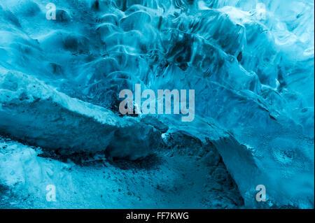 Ice cave at base of Jokulsarlon Glacier, Iceland - Stock Photo