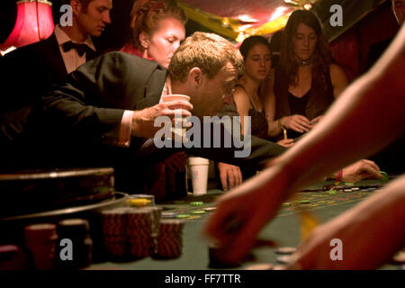 Placing bets on a table in The Lost Vagueness casino at the Glastonbury festival. Enter into the theatre of glitzy - Stock Photo