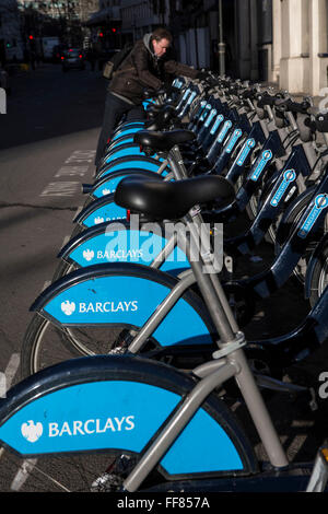Bikes lined up in the Barclays cycle hire stand, Liverpool Street, London, United Kingdom. These bikes, often called - Stock Photo
