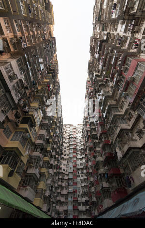 Very Crowded but colorful building group in Hong Kong - Stock Photo