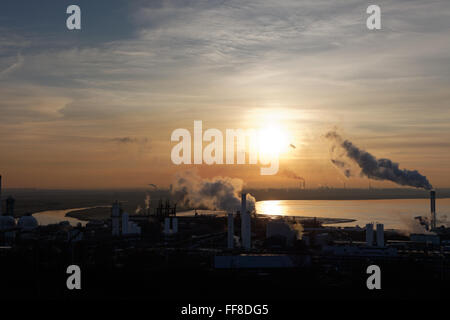 Landscape, industrial, smoking, chimneys, sunset, mersey, estuary, water, chemical, plant, pollution, environment,heavy - Stock Photo