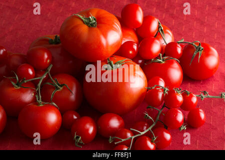 Tomatoes on a red tablecloth - Stock Photo