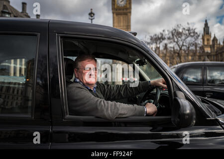 Thousands of London Black Cab drivers block roads in central London to protest against TfL's regulation of Uber, - Stock Photo