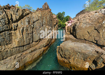 Young beautiful woman among the coastal cliffs. - Stock Photo