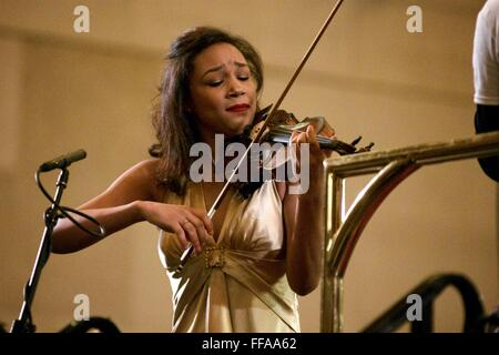 Violin virtuoso Adé Williams solos during her debut with the Philadelphia Orchestra. - Stock Photo