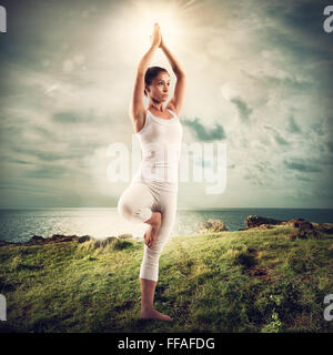 Yoga in a natural landscape - Stock Photo