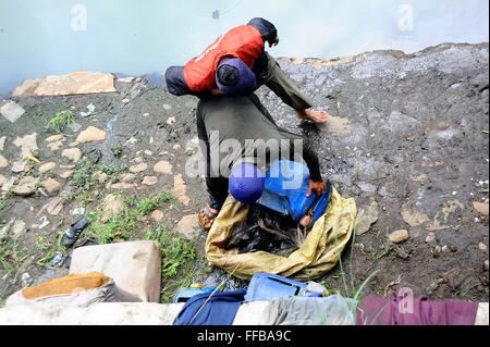 Jakarta, Indonesia. 11th Feb, 2016. Fish Hunters collecting their catch at River side, in Jakarta, Indonesia. Fishes - Stock Photo