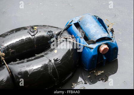 Jakarta, Indonesia. 11th Feb, 2016. Fish Hunter's factitious canoe at River in Jakarta, Indonesia. Fishes catch - Stock Photo