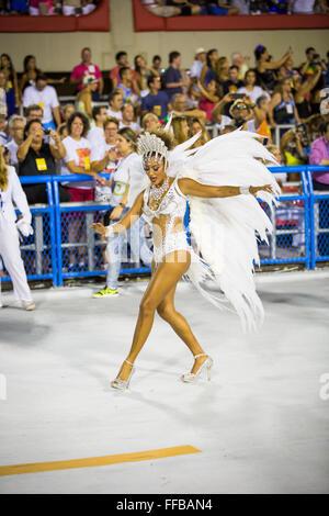 Samba dancers parade in the Sambadrome during the Rio Carnival February 21, 2015 in Rio de Janeiro, Brazil. - Stock Photo