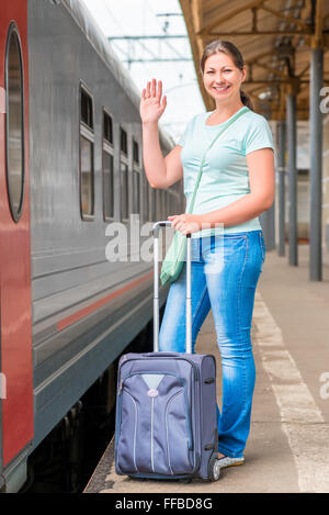 young beautiful woman goes on vacation by train - Stock Photo