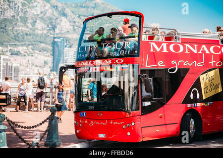 Touristic bus on street. Le grand tour is a official touristic bus service that shows the city Monte Carlo, Monaco - Stock Photo