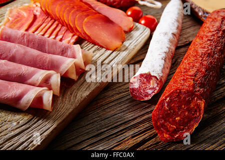 Tapas sausage mix from Spain jamon iberico lomo cheese ham chorizo olives - Stock Photo