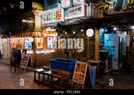 Tokyo, Japan - January 21, 2016: Japanese restaurants at the Yakitori Alley in Yurakucho Under the JR Yamanote Tracks. - Stock Photo