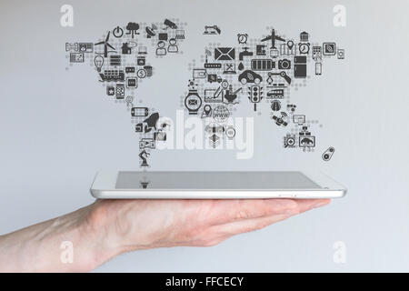 Global mobile devices and internet of things concept. Hand holding modern tablet or smart phone with neutral background. - Stock Photo