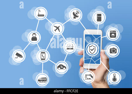 Internet of things security concept illustrated by hand holding modern smart phone with connected sensors in objects. - Stock Photo