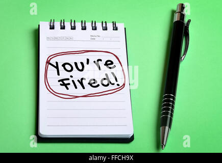 You are fired word on notebook page - Stock Photo