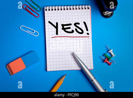 Yes word on notebook page - Stock Photo