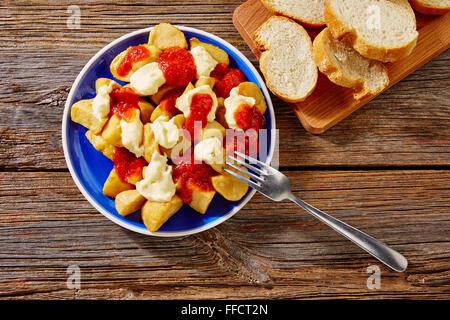 Tapas Patatas Bravas potatoe fries with tomato and mayonaise from Spain - Stock Photo