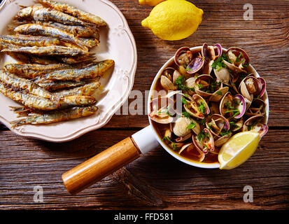 Tapas spanish seafood clams shrimps calamari romana and fried anchovies fish - Stock Photo