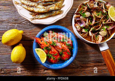 Tapas spanish seafood clams shrimps and fried anchovies fish - Stock Photo