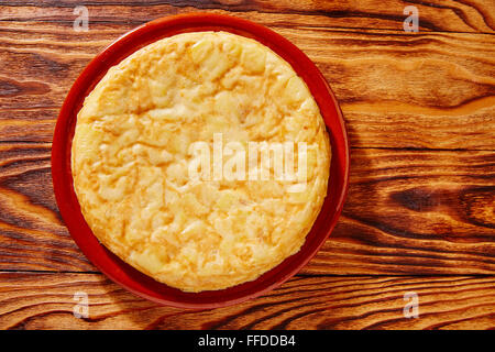 Tapas tortilla de patata potatoes omelette in wooden table from Spain - Stock Photo