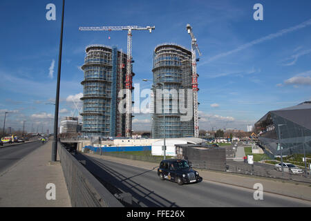 Hoola Development of 23-and 24-storey residential apartment towers in the Royal Victoria Docks area of East London, - Stock Photo