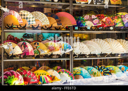Window of a souvenir shop full of fans on a street of the Gothic Quarter of Barcelona, Catalonia, Spain - Stock Photo